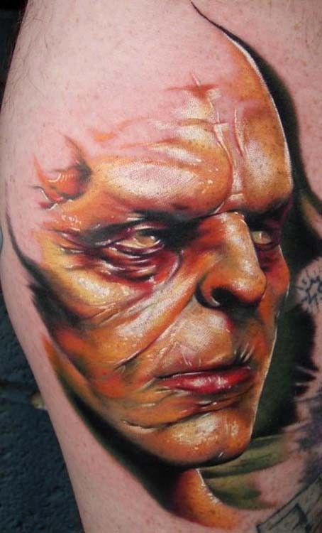 3D style colored creepy looking monster man face tattoo on leg