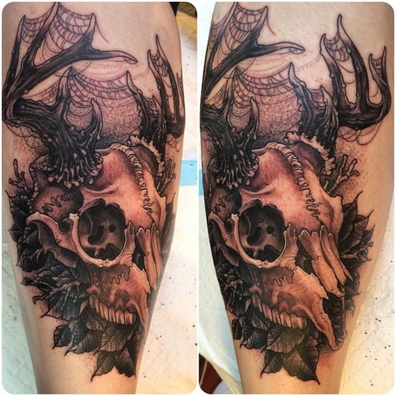 3D style colored deers skull with leaves tattoo on leg