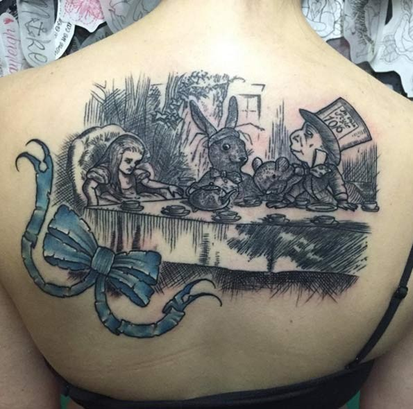 3D style colored famous cartoon picture tattoo on upper back with blue bow