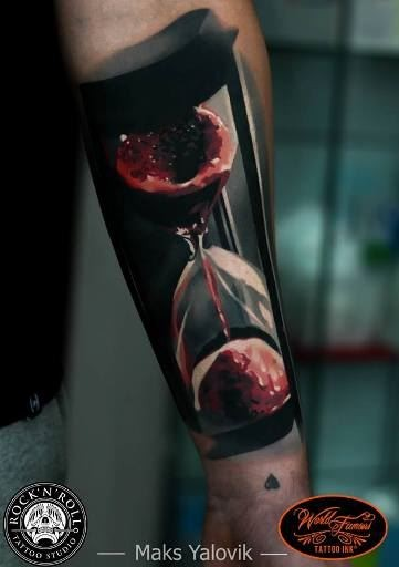 3D style colored forearm tattoo of bloody clock