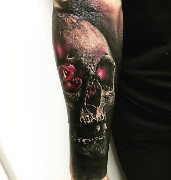 3D style colored forearm tattoo of magical skull