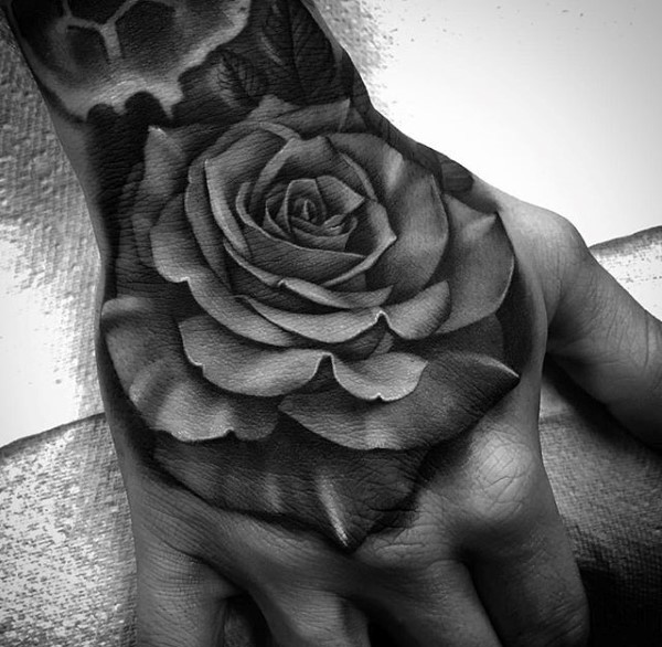 3D style colored hand tattoo of dark rose