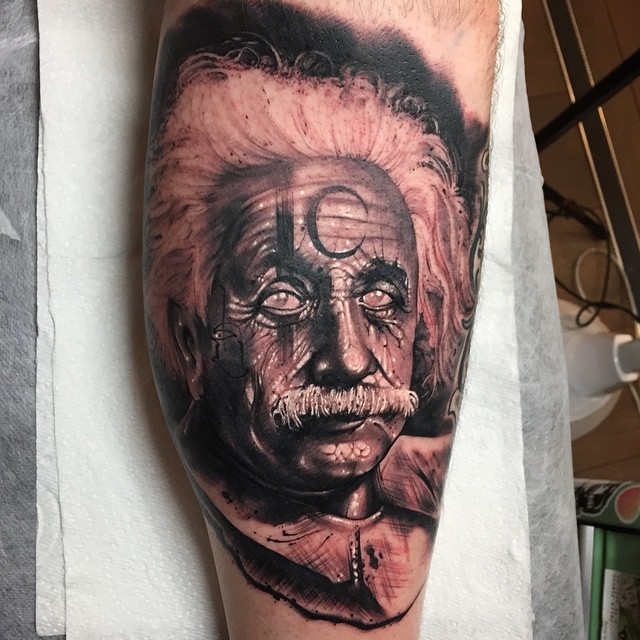 3D style colored leg tattoo of Albert Einstein portrait stylized with mystical symbols