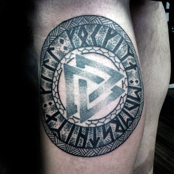 3D style colored leg tattoo of ancient symbol with lettering