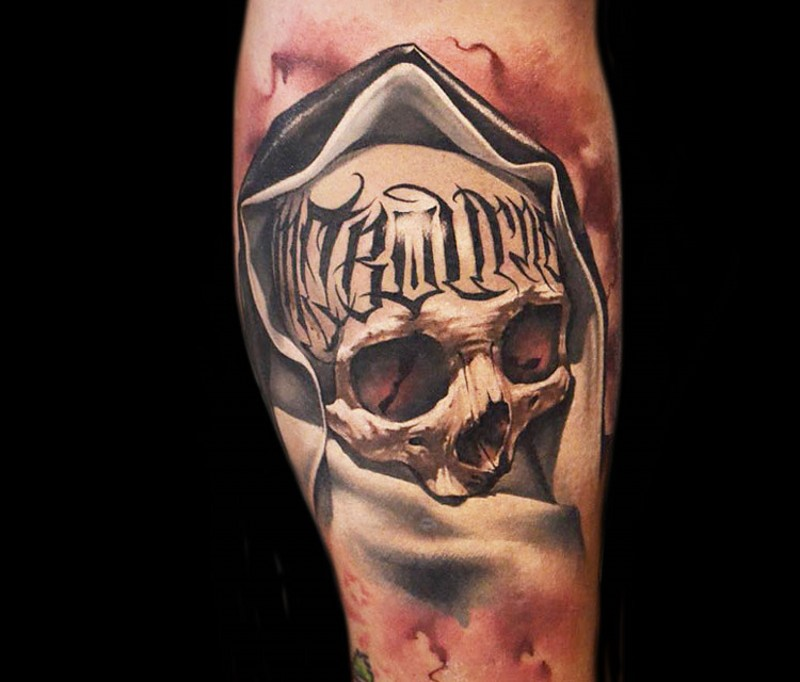 3D style colored leg tattoo of human skull in hood with lettering