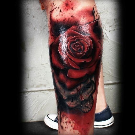 3D style colored leg tattoo of red rose with skull
