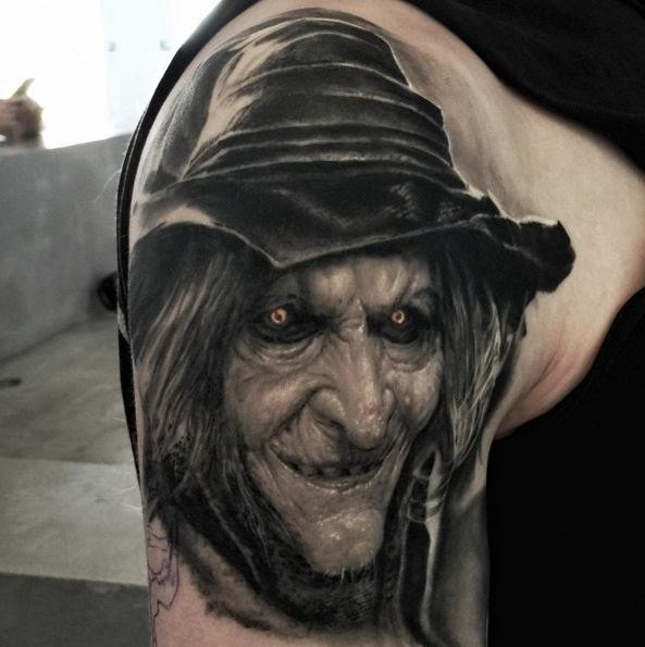 3D style colored shoulder tattoo of creepy witch