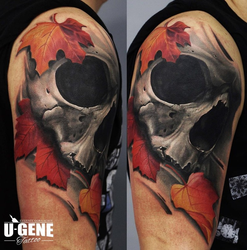 3D style colored shoulder tattoo of human skull with maple leaves
