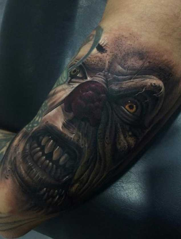 3D style colored very detailed evil monster clown face tattoo