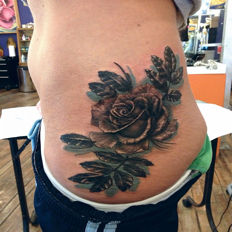 3D style colored waist tattoo of rose with feather