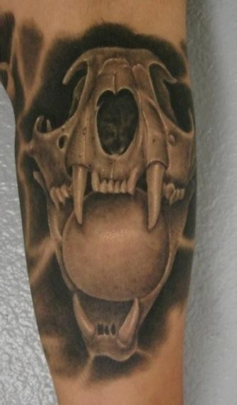 3D style creepy looking cat skull with orb tattoo on arm