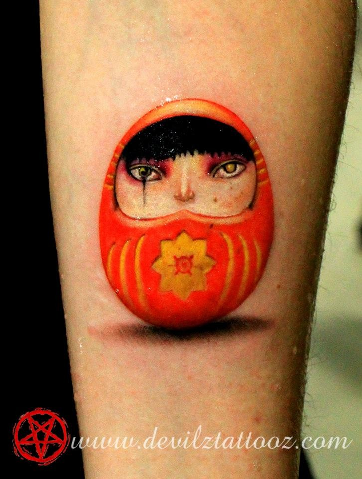 3D style cute looking arm tattoo of small daruma doll with symbol