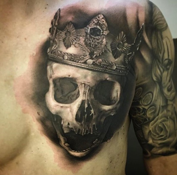 3D style detailed chest tattoo of human skull with big crown