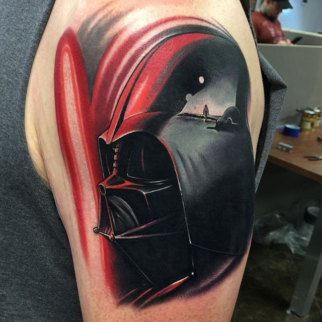 3D style detailed colored shoulder tattoo of Darth Vader and red saber