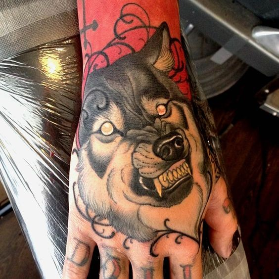 3D style detailed demonic wolf tattoo on hand