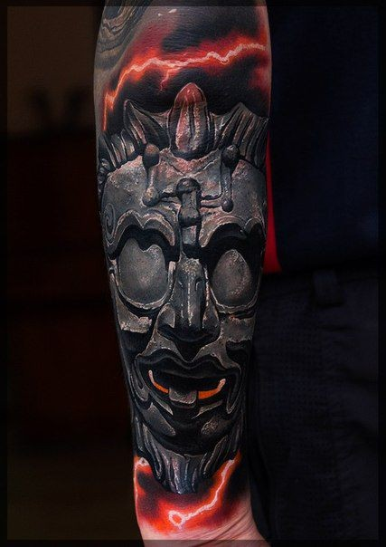 3D style detailed forearm tattoo of colored ancient mask