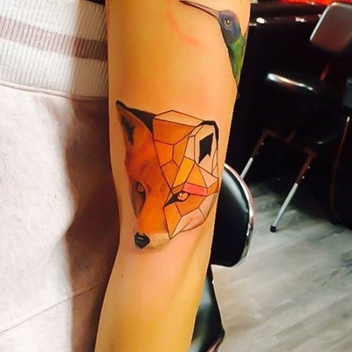 3D style geometrical style arm tattoo of cute fox