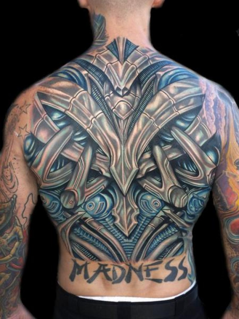 3D style multicolored funny looking colored alien armor tattoo on whole back with lettering
