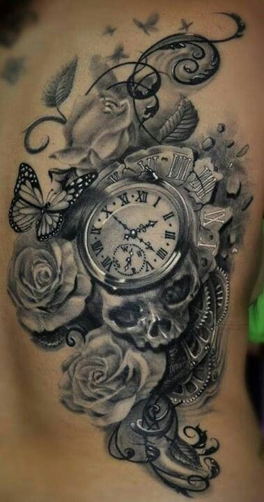 3D style natural looking black and white old vintage clock tattoo on back with butterfly and skull