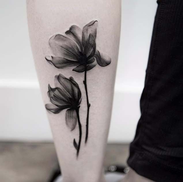 3D style natural looking black ink forearm tattoo of two flowers