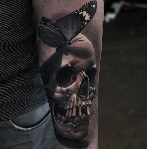 3D style neo traditional style colored forearm of human skull with butterfly