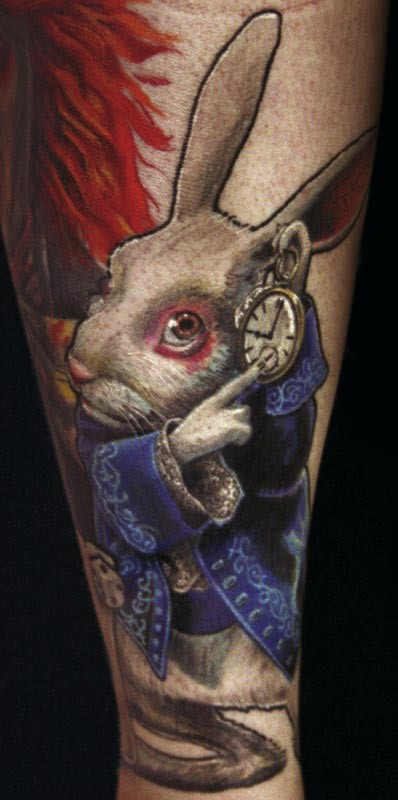 3D style painted and colored Alice in wonderland rabbit tattoo on forearm