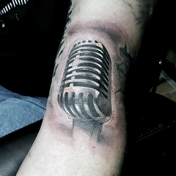 3D style painted big black and white microphone tattoo on arm