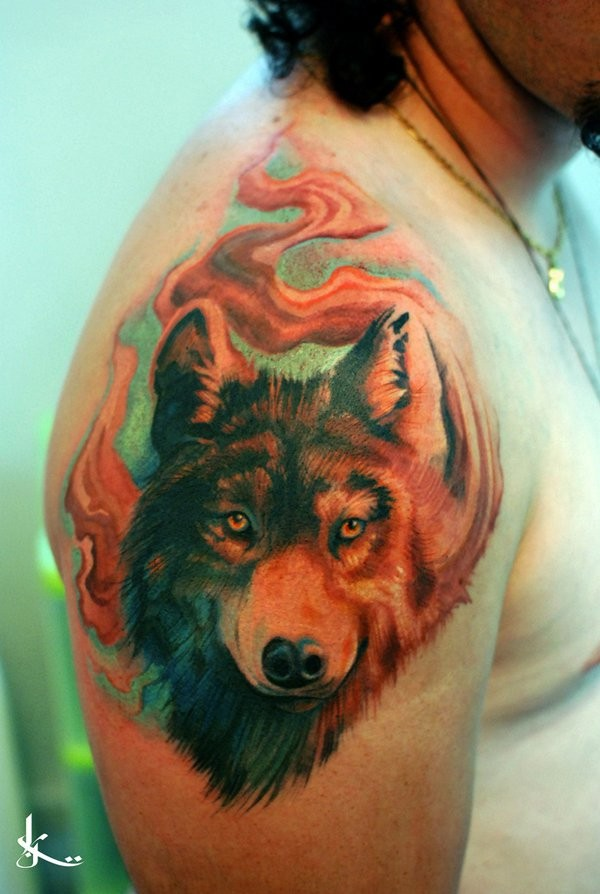 3D style painted natural looking colored wolf head tattoo on shoulder combined with mystical fog