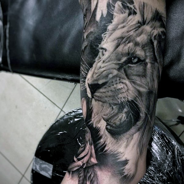 3D style realistic looking arm tattoo of lion head
