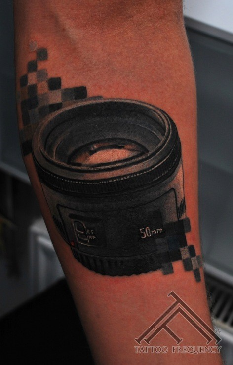 3D style realistic looking camera lens tattoo on forearm