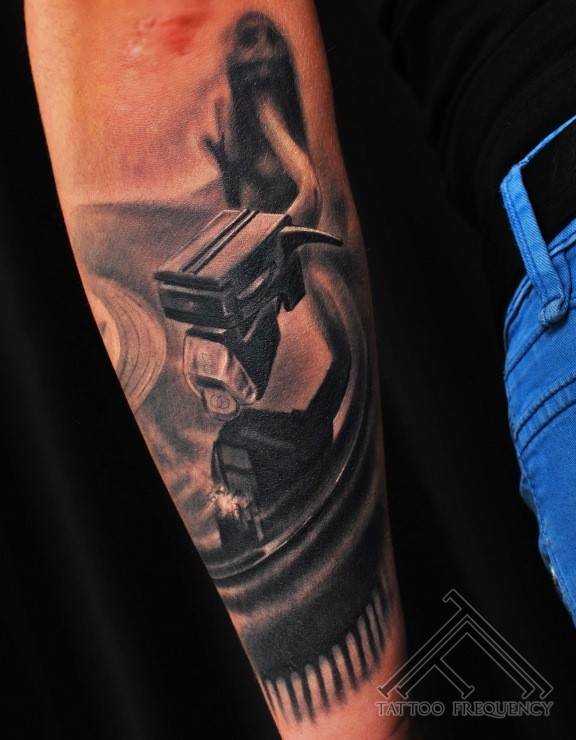 3D style realistic looking old vinyl player tattoo on forearm