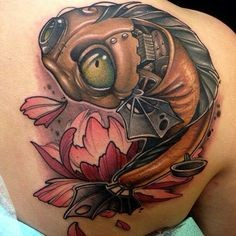 3D style unique designed biomechanical fish tattoo on back with pink flower