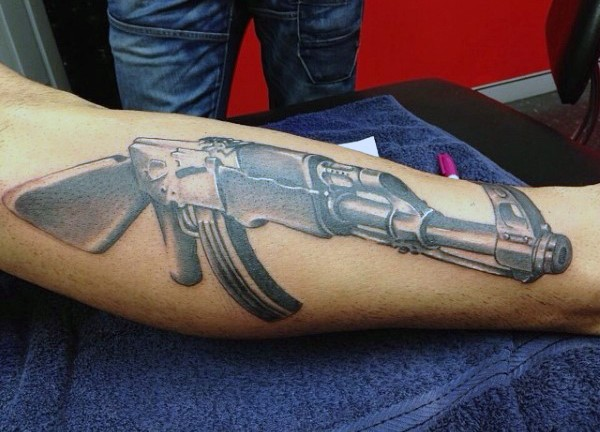 3D style very detailed AK rifle tattoo on arm
