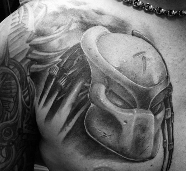 3D style very detailed chest tattoo of detailed Predators helmet