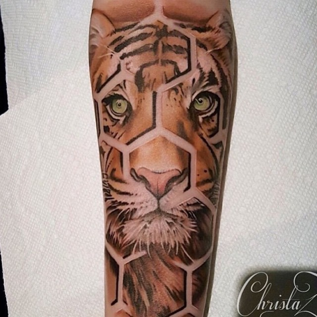 3D style very detailed colorful fragmented tiger tattoo on forearm