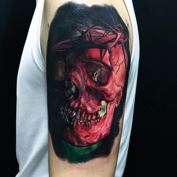 3D style very detailed shoulder tattoo of red human skull with vine