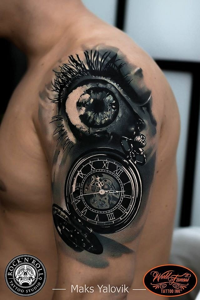 3D style very detailed shoulder tattoo of old clock with eye
