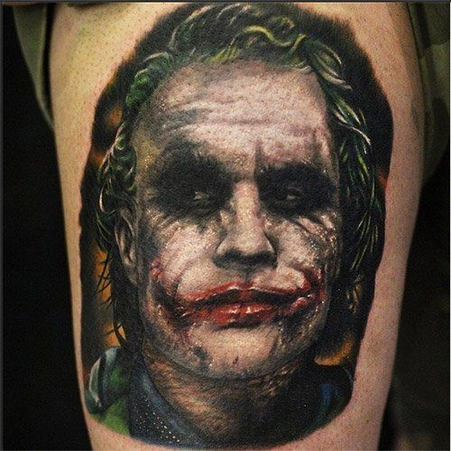 3D very detailed colored thigh tattoo of evil Joker