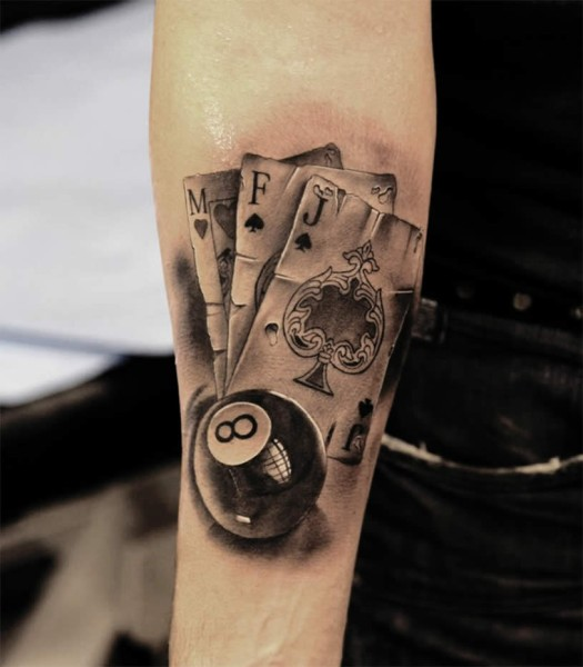 3D very detailed forearm tattoo of playing cards and pool ball