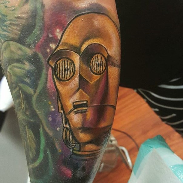 3D very detailed natural looking C3PO portrait tattoo on arm