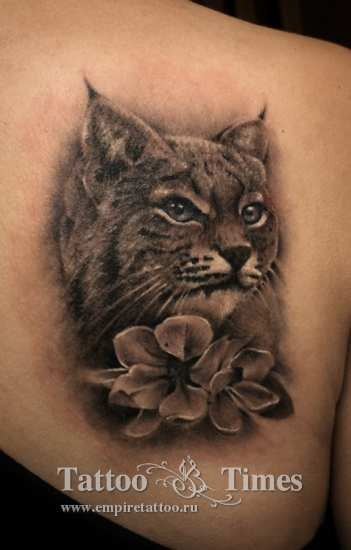 3D very realistic black and white wild cat with flower tattoo on shoulder