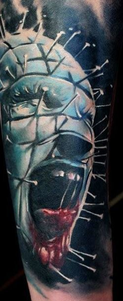 3D very realistic colored horror movie hero bloody face tattoo on arm