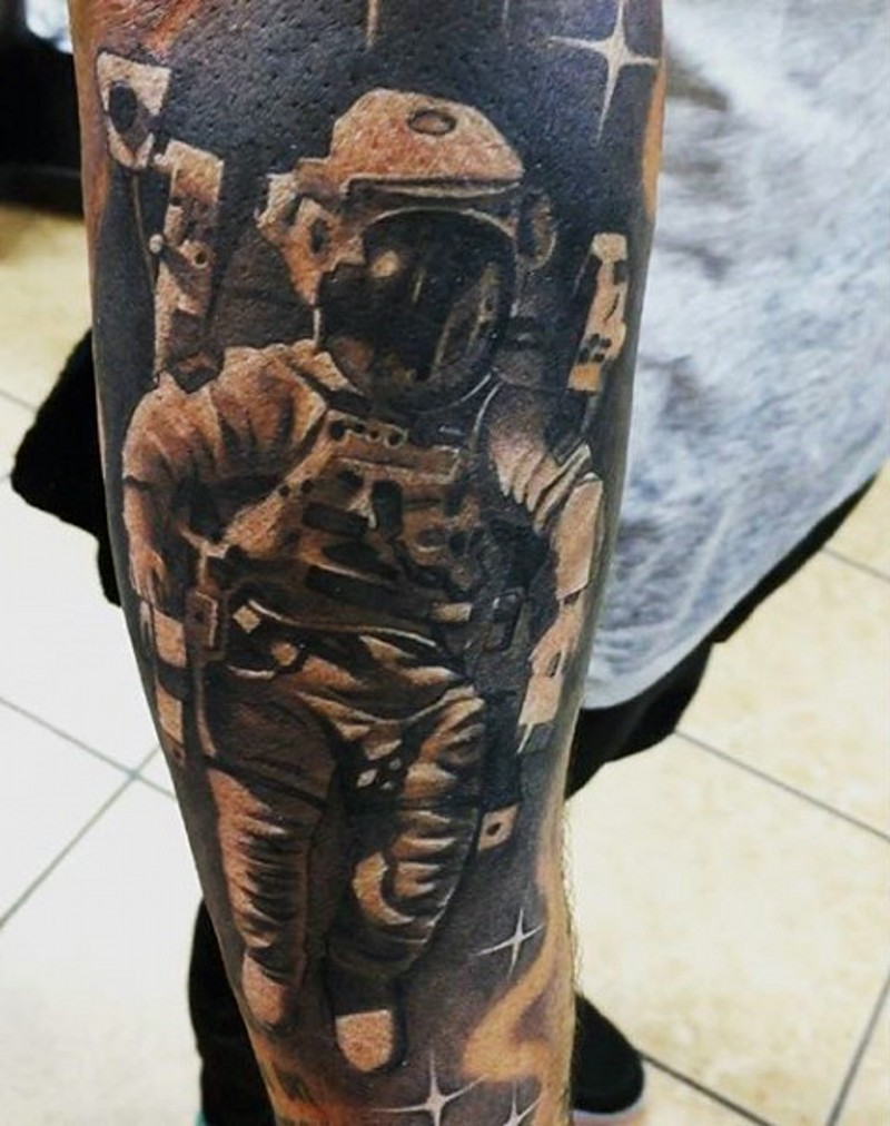 3D very realistic looking black and white astronaut tattoo on arm