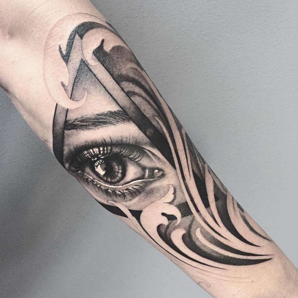 Abstract  black and grey tattoo on forearm