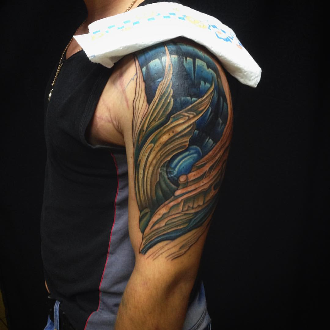 Abstract organic tattoo on shoulder