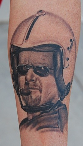 Accurate painted black ink pilot portrait tattoo on forearm
