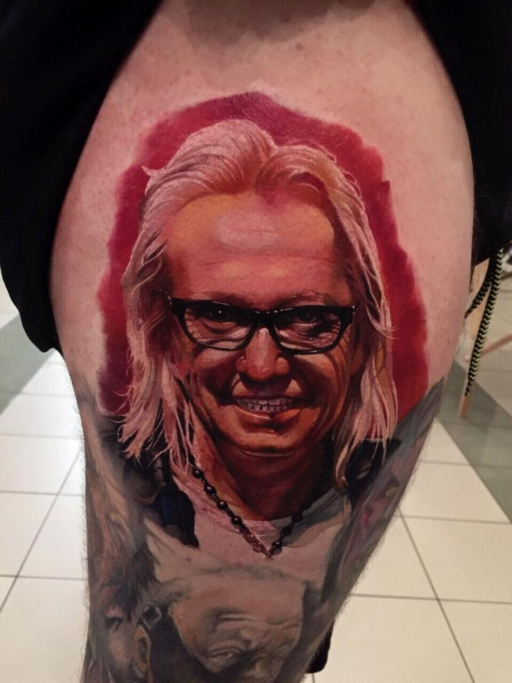 Accurate painted colored thigh tattoo of famous artist portrait