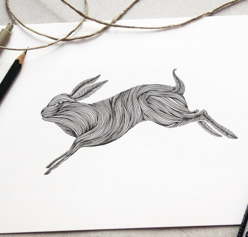 Amazing-printed rushing forward hare tattoo design
