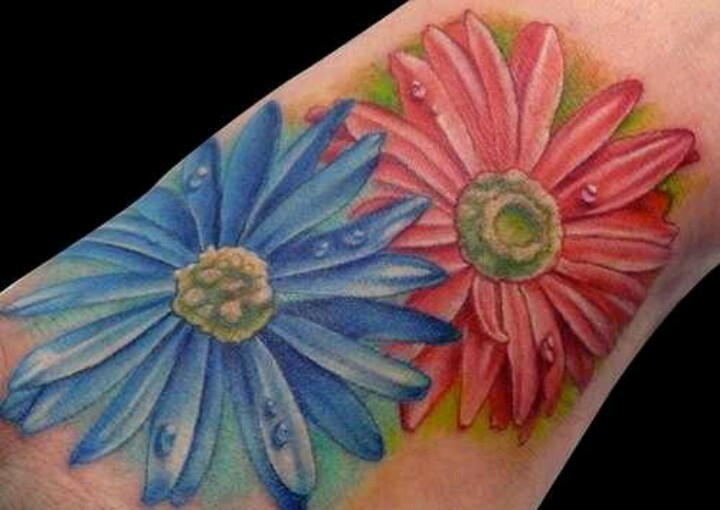Amazing colorful aster flowers tattoo