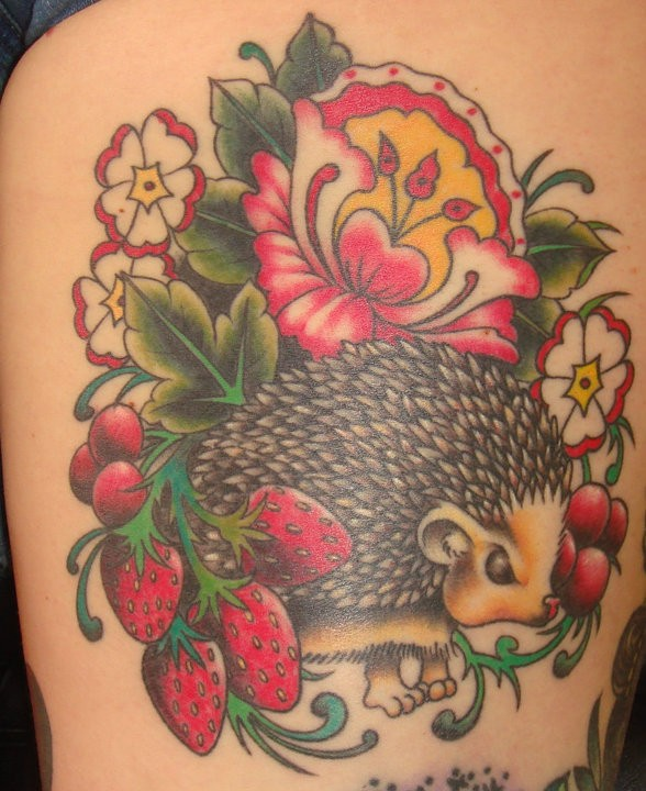 Amazing colorful hedgehog with berries and flowers tattoo